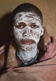 Xhosa boy undertake manhood ceremony in rural Eastern Cape, South AfricaXhosa-cultuur,-ritueel, mannen met witte gezichten, Xhosa-cultuur,-ritueel, mannen met witte gezichten,